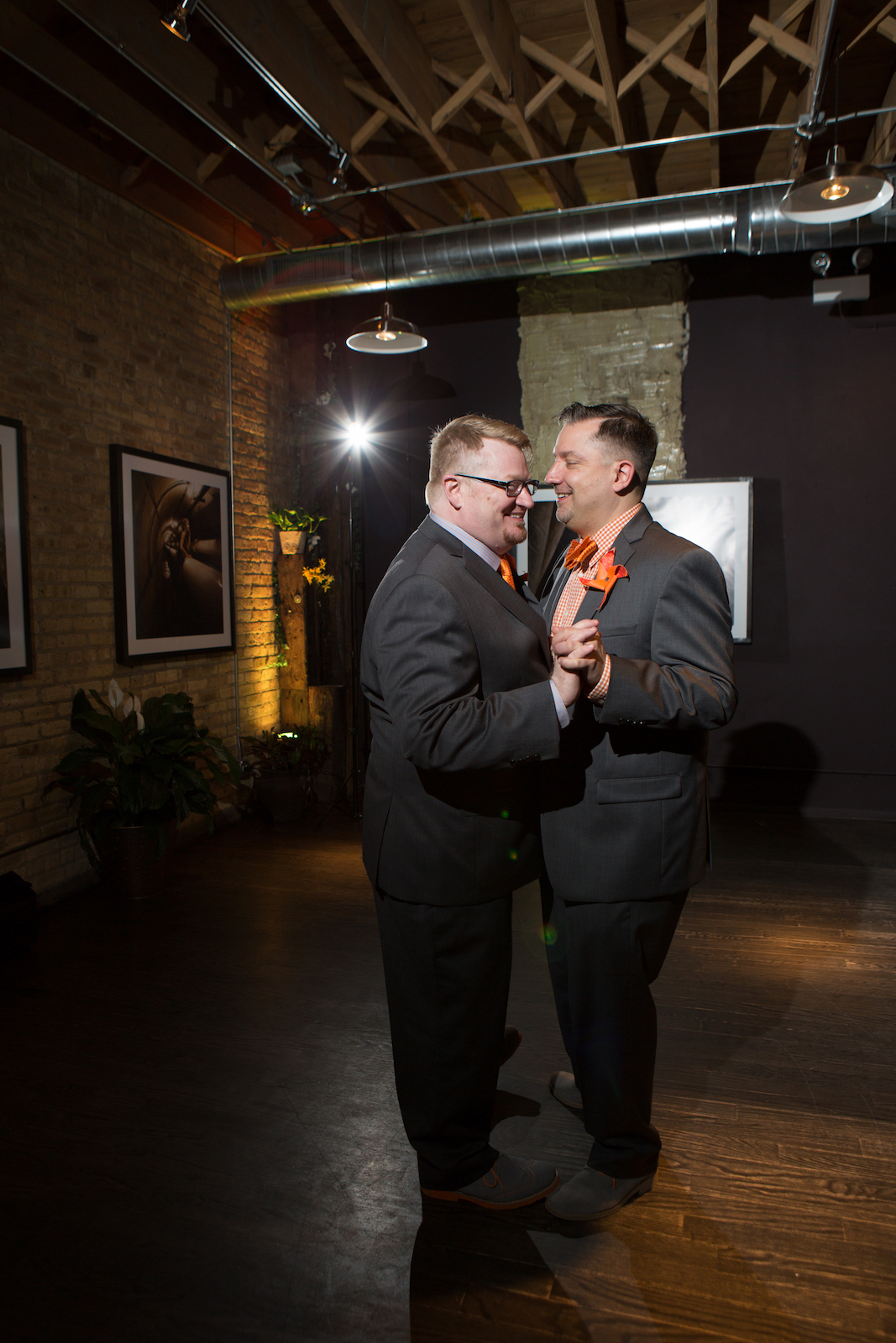 Two Grooms share their first dance at their Chicago wedding. © Cristina G Photography