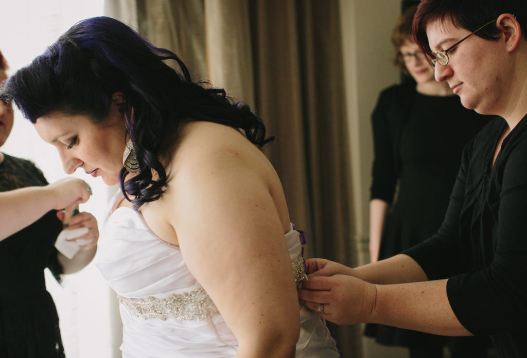 Helping you into your wedding gown - just one of the many things I'll do as your Wedding Manager! Photo © Justine Bursoni Photography