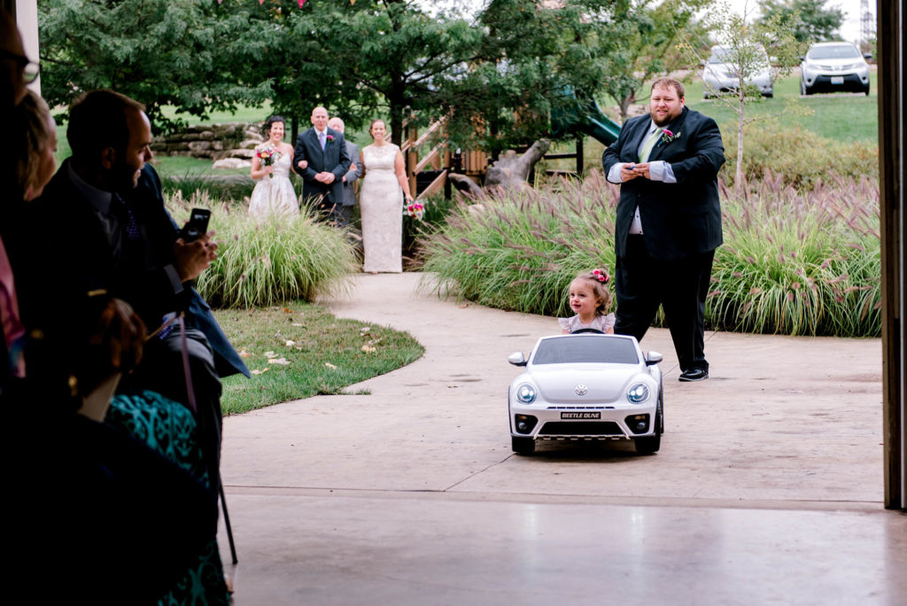 Flower Girl rides up the aisle in remote control car