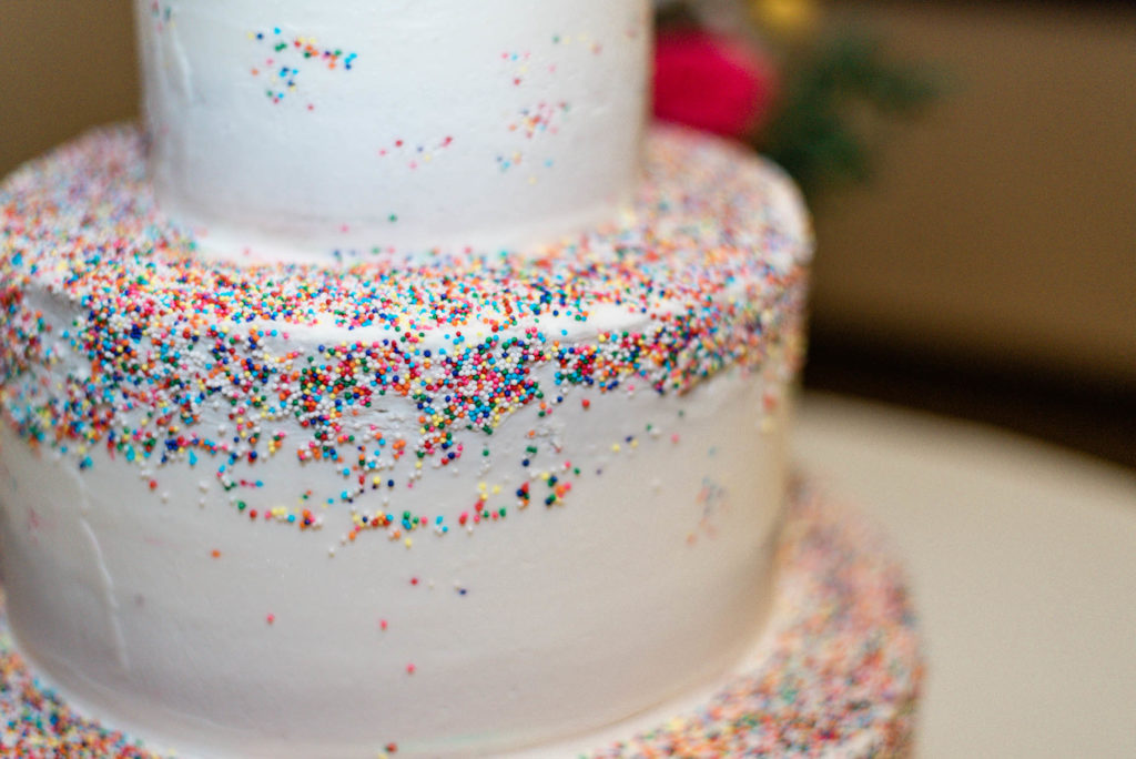 Rainbow sprinkles on 3-tier wedding cake