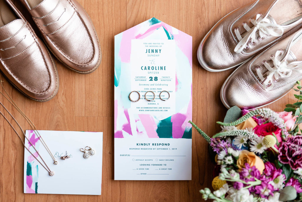 Rose Gold Wedding Keds next to Bright Color Wedding Flowers & Invitations
