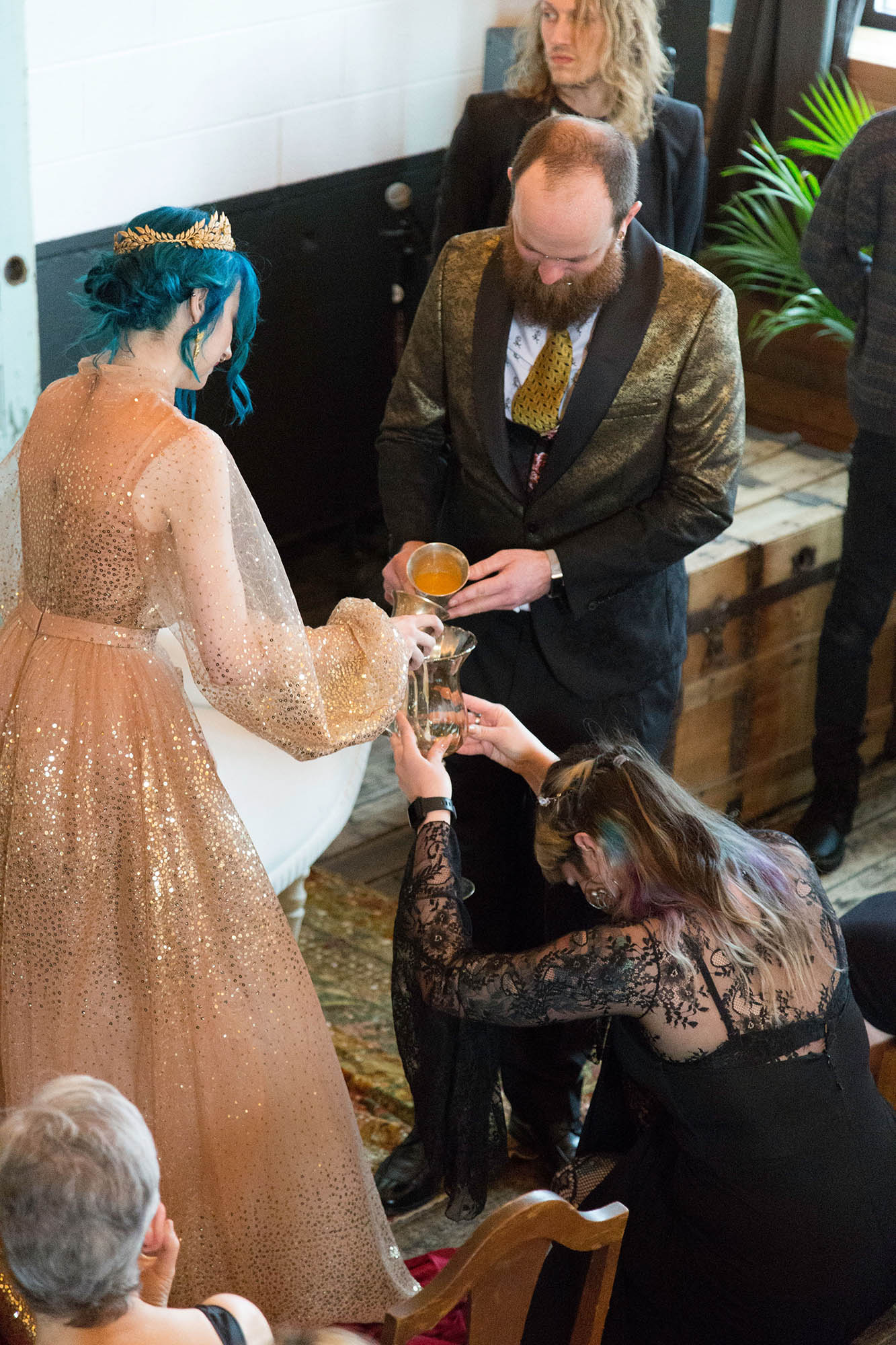 Bride and Groom Pour Edible Glitter into Chalice at Goth Wedding Ceremony