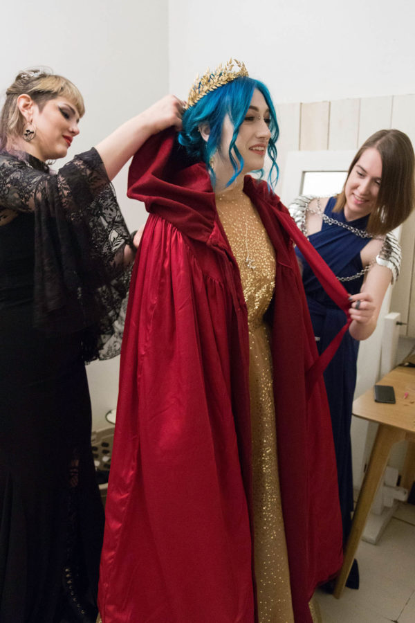 Bridesmaids help Bride put on Red Wedding Cape and Crown