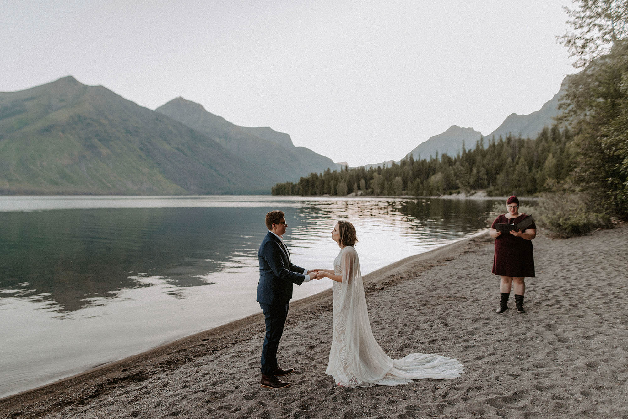Two brides and wedding officiant at Glacier National Park elopement