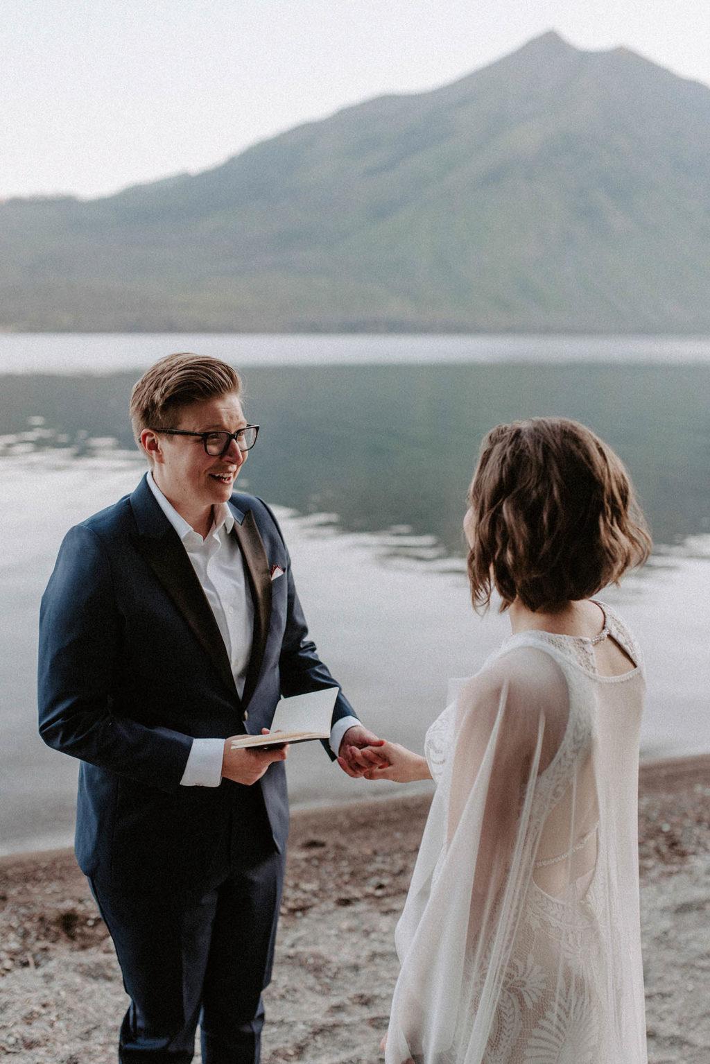 bride reads wedding vows to her partner