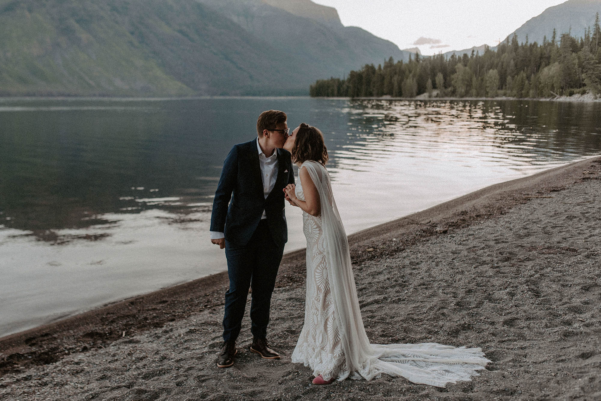 two brides kiss at Glacier National Park elopement