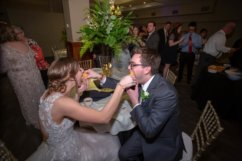 bride and groom feed each other Skyline chili dogs