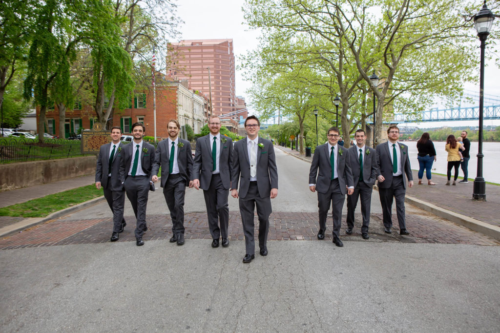 groom and groomsmen in gray suits with green ties in Cincinnati